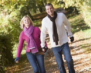 Couple holding hands on walk