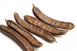 Carob pods isolated on white